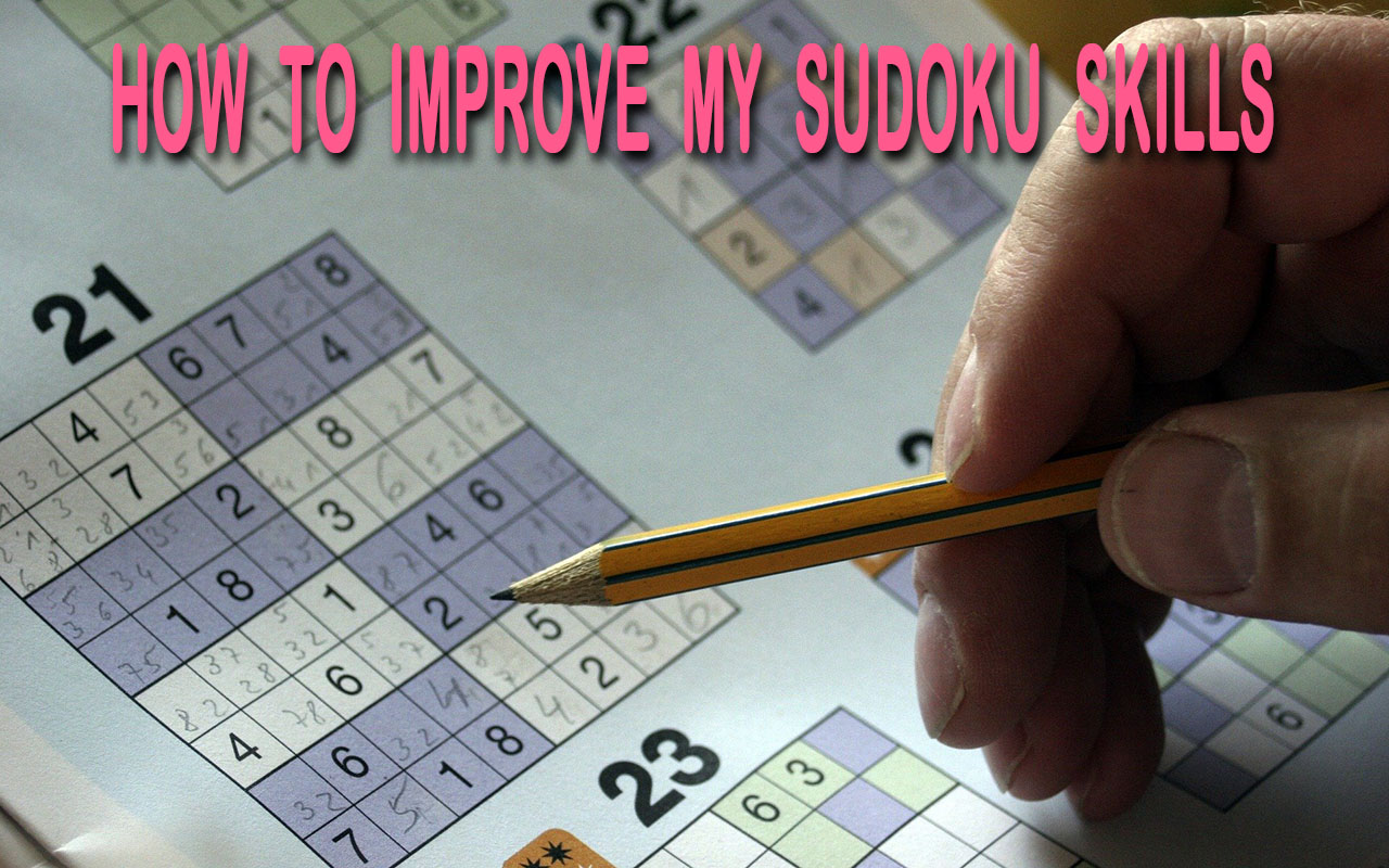 A hand holding a pencil struggling to solve a sudoku puzzle in the newspaper.
